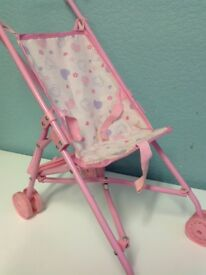 Dolls pushchair(s)