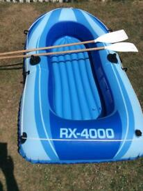 Inflatable boat oars included