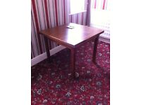 Extending solid wood table.