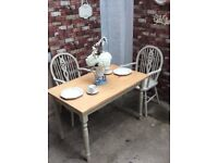 Farmhouse table and two carver chairs