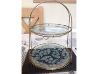 Two tiered cake stand with glass leaf patterned plates