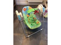 Green fisher price baby rocker/swing