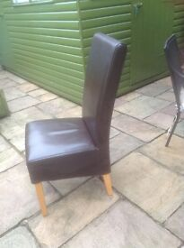 70 Dark Brown faux leather dining chairs. They are surplus to requirements (new decor)