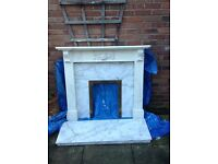 Fire surround with marble hearth and back.