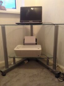 Glass corner table with chrome legs