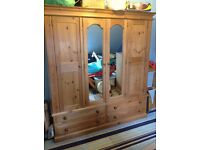 Large wardrobe with mirrors and drawers