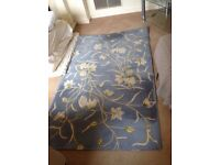 pure wool rug 41 x 67 in good clean condition some wear and tear at edges see photos