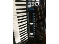 Roland FR3X Digital Accordion, Harley Benton portable amp and Roland backing module