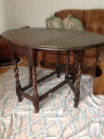 A lovely Solid Oak Oval Top Gateleg Table