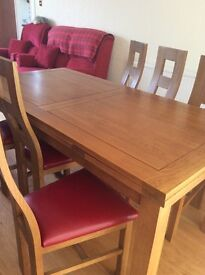 Solid 6 oak chairs with red leather seats 1yr old very gcondition