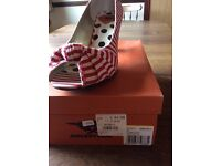 Red and white stripe Rocket Dog shoes
