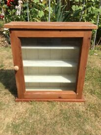 Glass front wooden cabinet
