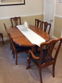 Cherry wood dining table and six chairs
