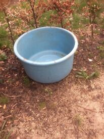 Round blue fibre glass tank or small pool can be used for breeding fish or as a paddling pool