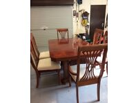 Mahogany dining table 4 chairs and 2 carvers with cream covers can seat up to 10 £250.00 ono