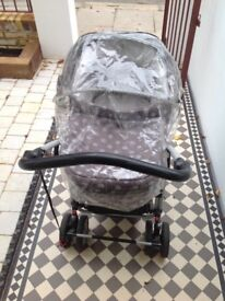 Mama's and Papa's pram with detachable raincover and buggyboard included.