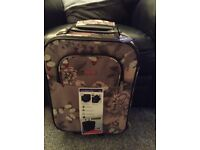 Small lightweight cabin size suitcase brand new.