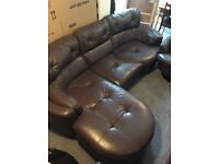 Muted purple leather sofa and rotating chair