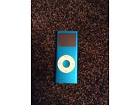 Blue iPod nano (4th generation) with speakers / docking station