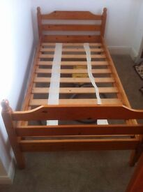 Solid oak wooden Single beds two in number excellent condition. Readily available for pickup