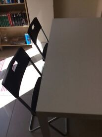 Ikea White Dining table with 6 black foldable chairs