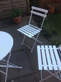 Metal, white, folding garden table and chairs. Excellent condition. Ready for collection.