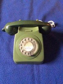Retro vintage style 1970's green desk phone.