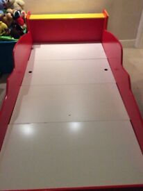 Racing car bedframes for sale. Two bedframes are available. (Twins.)