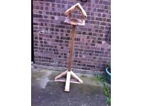 Rustic style birdhouse made from recycled timber.