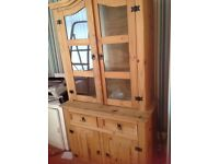 Two sideboards and a glass and wood dresser, strong sturdy pieces of furniture