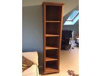 Tall dark solid oak bookcase