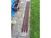 3 x 2.4m Half Round Wooden Posts pre-drilled for vine eye bolts ( inc ) + wire - £ 25