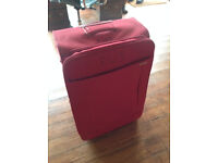 Samsonite suitcase on wheels. Red, used only twice.