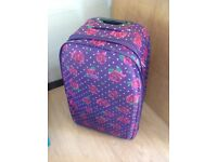 Large suitcase in purple