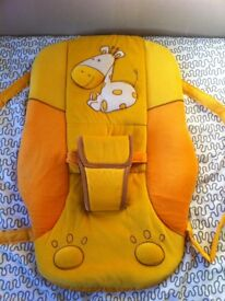 YELLOW/ORANGE ROCKER CHAIR WITH GIRAFFE DESIGN