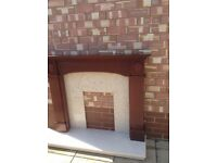 Fire surround Marble hearth, back plate, and mahogany fire surround