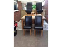 SOLID OAK DINING TABLE AND 4 BROWN LEATHER HIGH BACK CHAIRS