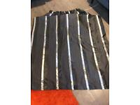 Black and grey pencil pleat curtains