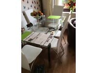Glass and chrome table and six chairs