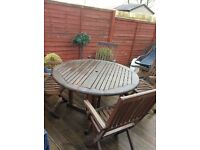 Garden furniture... table and four chairs wooden