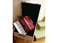 Accordion 24bass Rossini with hard case. Learner box, almost new.