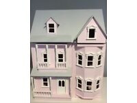 Wooden hand painted dolls house
