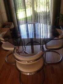 Glass dining table and chairs (1970's)