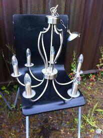 lovely light steel Gold finish chandelier light, works as it should