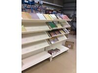 Double sided retail shelving with sloping shelves set up