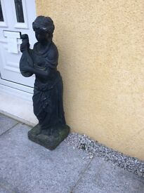 2 black garden statues