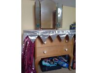 Dressing table with mirrors, and wrap around curtains. 122 cm tall, 89 cm wide and 48 cm deep.