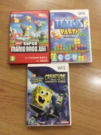 3 wii games: New super mario bros Tetris party deluxe and spongebob squarepants game