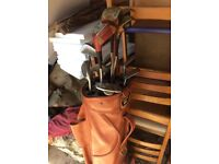 A NEW golf club set and a great leather bag two