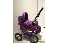 Doll's Pram hardly used in excellent condition.